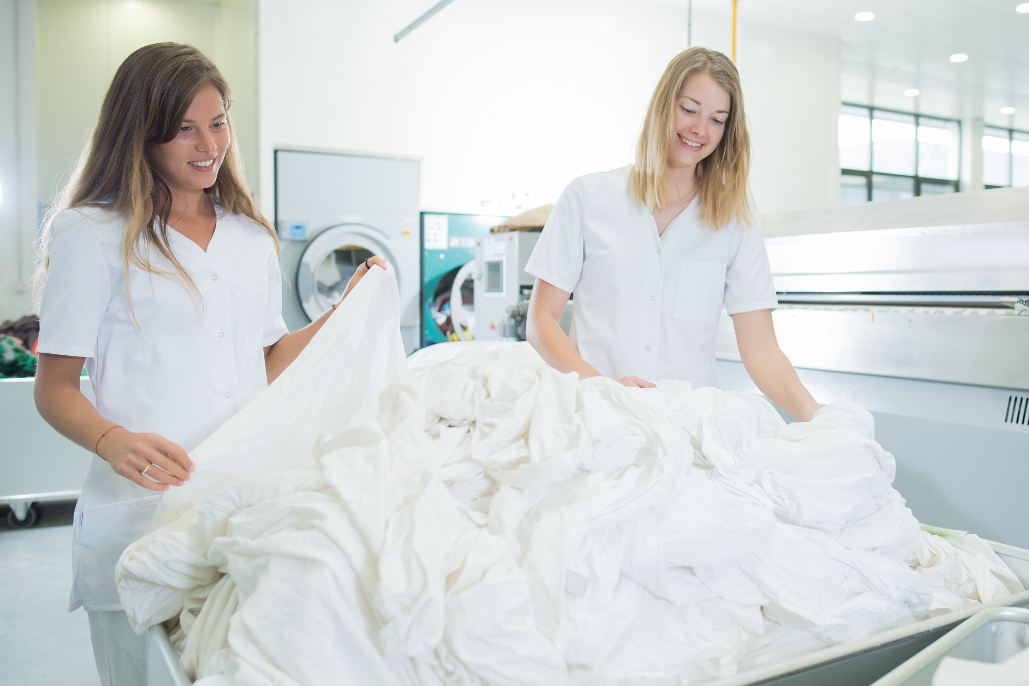 two women working in a laundry room